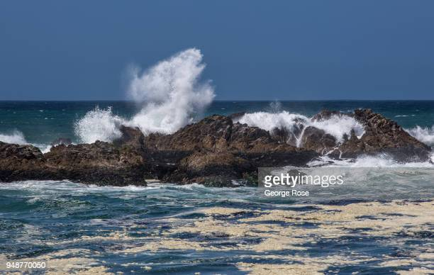 Large ocean waves crash on the shoreline rocks near Spanish Bay located along the famed 17Mile Drive on April 10 in Monterey California An estimated...