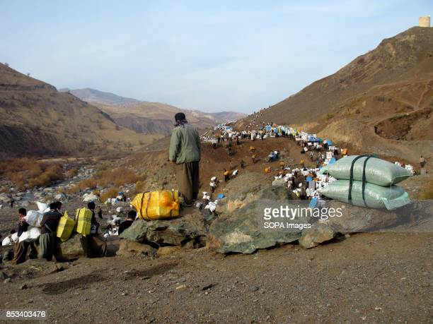Large of Kurds are crossing the border carrying heavy boxes to earn money For decades the IraqIran border has served as a smuggling route mainly to...