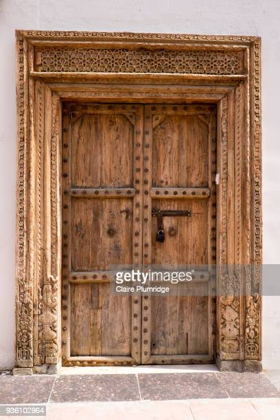 large old wooden ornate door - claire plumridge stock pictures, royalty-free photos & images