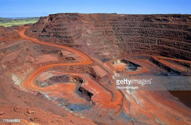 large open cut iron ore mine - iron ore stock photos and pictures