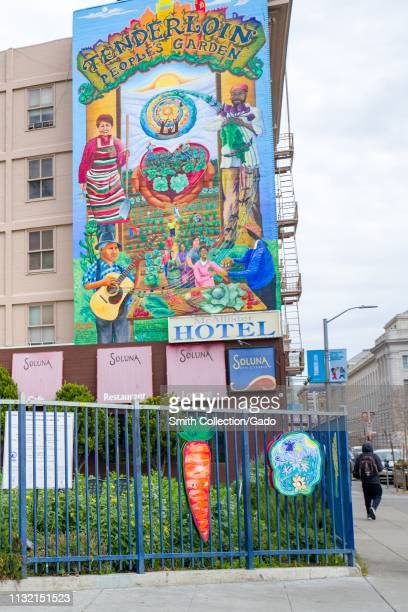 Large ornate mural above the Tenderloin Peoples' Garden in the Tenderloin neighborhood of San Francisco California February 25 2019