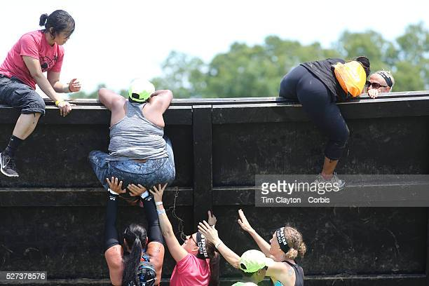 Large oversized women competitors in action at the wall climb obstacle during the Reebok Spartan Race Mohegan Sun Uncasville Connecticut USA 28th...