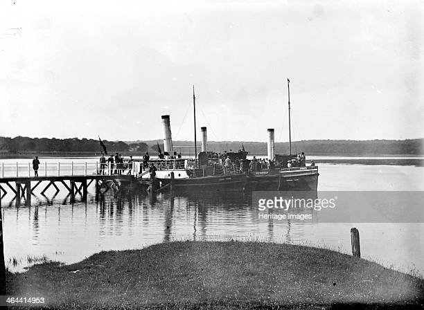 A large paddle steamer taking on passengers at the landing stage on River Beaulieu Beaulieu Hampshire c1860c1922