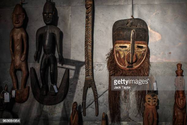 A large painted wood ceremonial mask sits among other examples of Tribal Art during a press preview at Summers Place Auctions on May 30 2018 in...