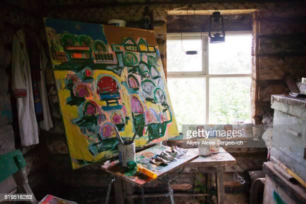 large painting in art studio - künstleratelier stock-fotos und bilder