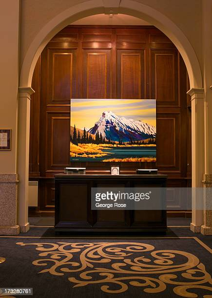 A large painting of the mountains hangs in the lobby of the Fairmont Chateau Lake Louise hotel on June 26 2013 in Lake Louise Alberta Canada Major...