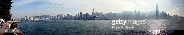 Large panorama taken from the Kowloon side of Hong Kong Harbor. A nice and sunny day, but a bit hazy from either the smog or just humidity.