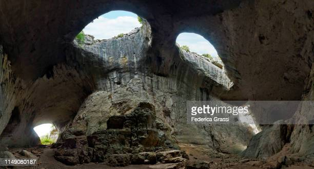 large panoramic view of prohodna cave, bulgaria - spelunking stock pictures, royalty-free photos & images