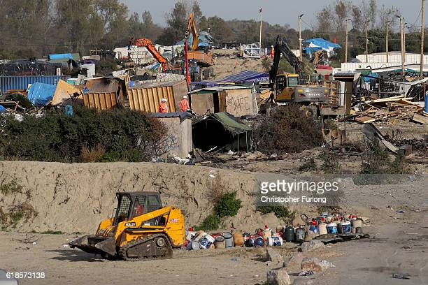 Large parts of the Calais 'Jungle' migrant camp are cleared as contractors demolish the site on October 27 2016 in Calais France Authorities have now...