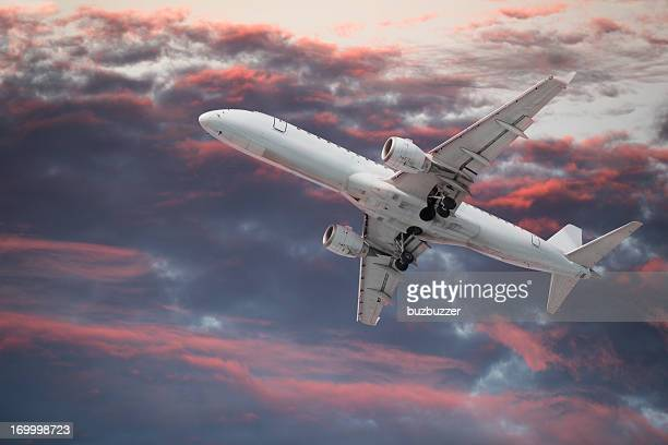 Large passenger Airplane flying in a colorful sky