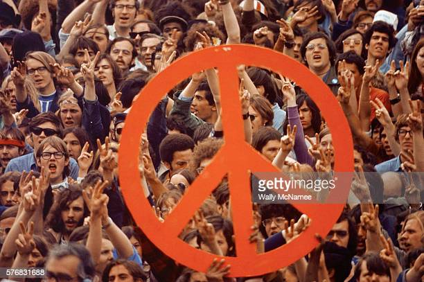 A large peace sign is held up by activists during a Vietnam War demonstration on Capitol Hill