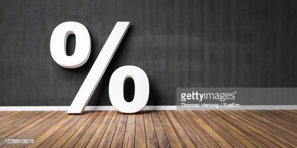 large percentage sign on hardwood floor - percentage sign stock pictures, royalty-free photos & images