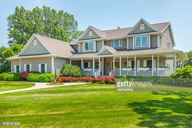 large, perfect, maintenance free home with covered porch - buildings stock pictures, royalty-free photos & images