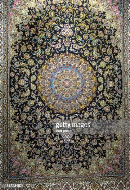 large persian carpet hung vertically - persian rug - fotografias e filmes do acervo