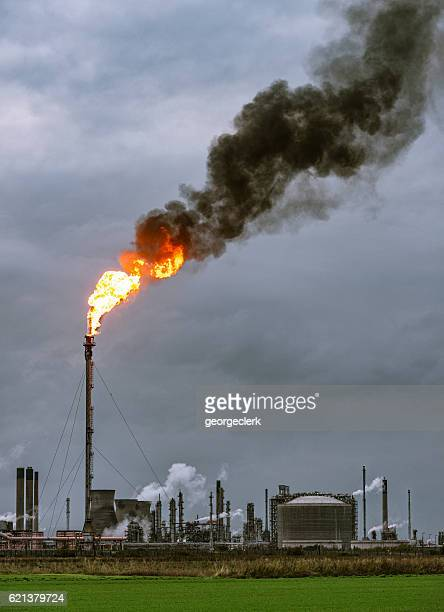 Large petrochemical flare and smoke
