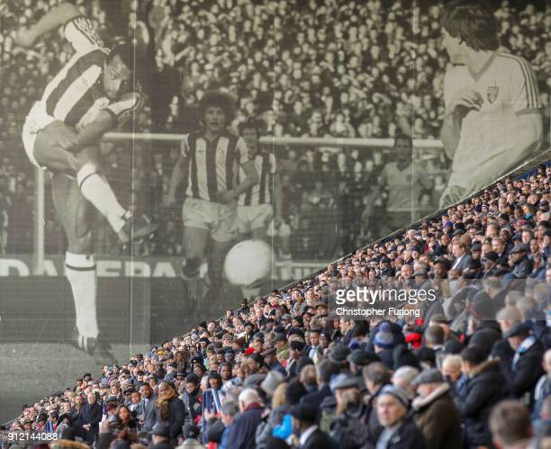 A large photo of Cyrille Regis is seen next to the East Stand at The Hawthorns during a memorial service for the former West Bromwich Albion and...
