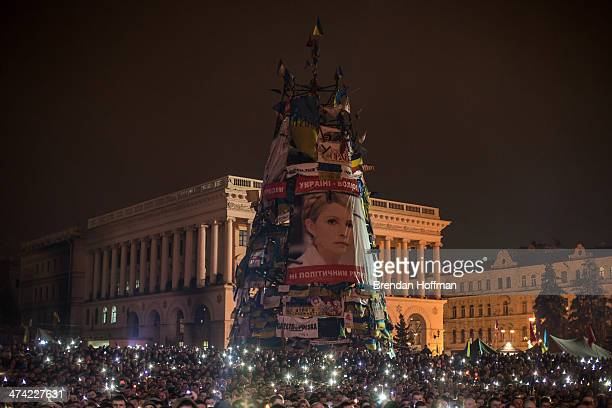 A large photograph of former Prime Minister Yulia Tymoshenko hangs on the side of a structure on Independence Square before her address to...