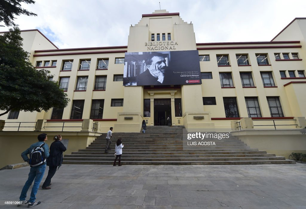A large photograph of late Colombian 1982 Nobel Prize in Literature laureate Gabriel Garcia Marquez hangs over the entrance to the National Library in Bogota, on April 21, 2014. Garcia Marquez, the author of 'One Hundred Years of Solitude', died on Thursday at age 87 in Mexico City. AFP PHOTO/Luis Acosta /