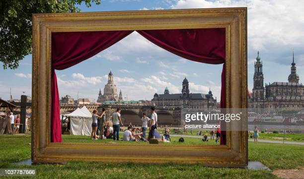 A large picture frame stands in front of the backdrop of the oldtown in Dresden Germany 17 August 2013 The frame showing the perspective of the...