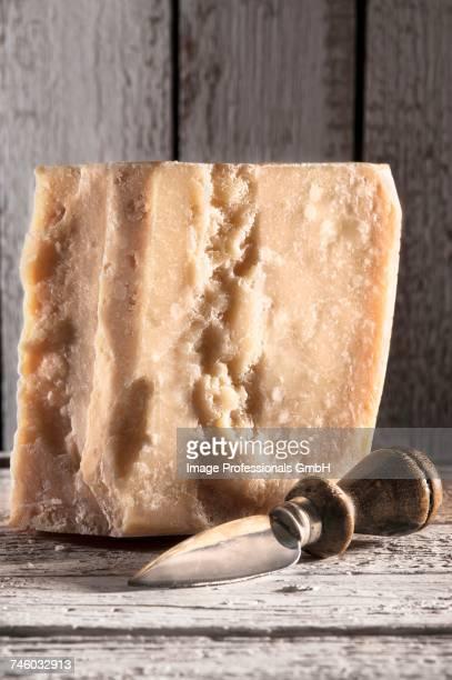 A large piece of Grana Padano cheese
