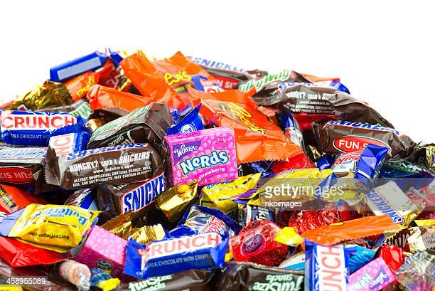 large pile of candy on white background - pile of candy stock photos and pictures