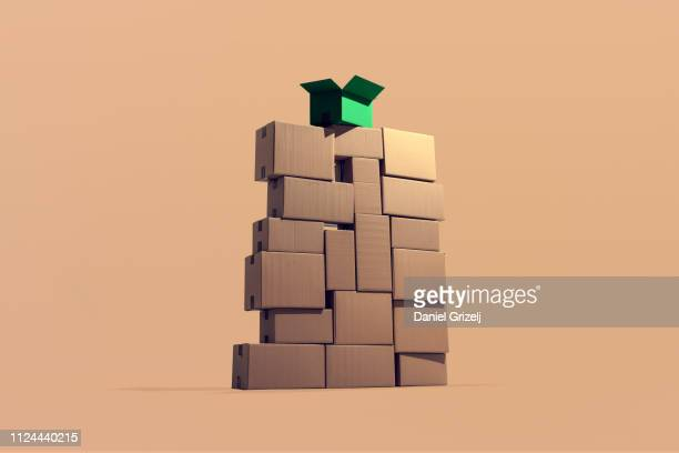 A large pile of cardboard boxes stacked on top of each other