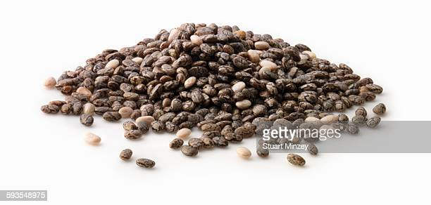 Large pile of chia seed on white background