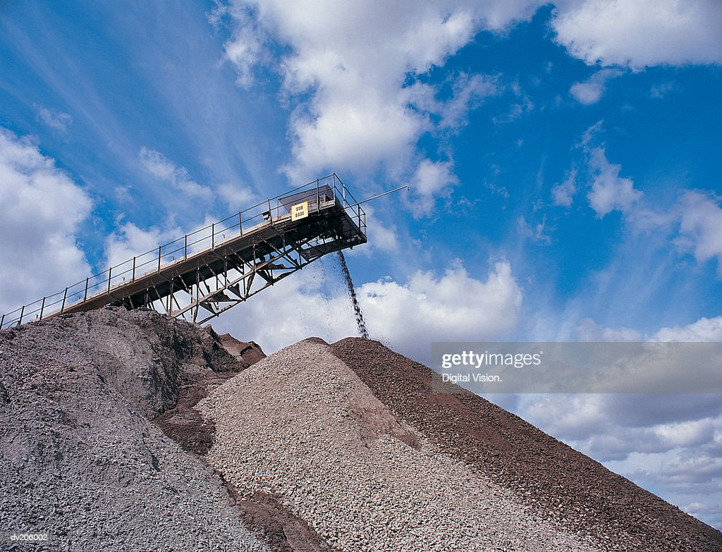 Large pile of gravel at quarry : Stock Photo