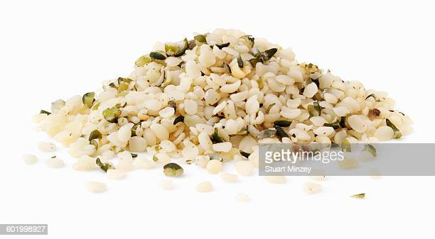 Large pile of hemp seeds on white background