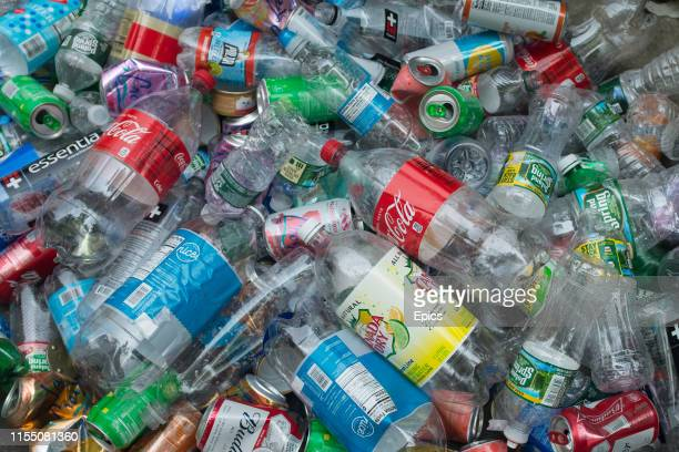 A large pile of plastic bottles and cans collected on a street corner in downtown Manhattan New York