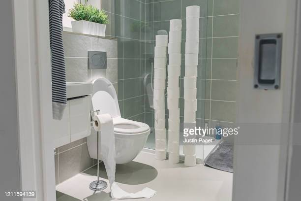 large piles of toilet rolls in bathroom - panic buying stock pictures, royalty-free photos & images
