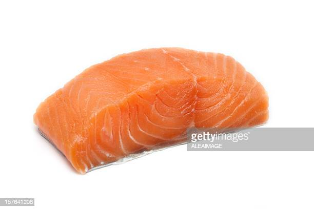 A large pink salmon fillet isolated on a white background