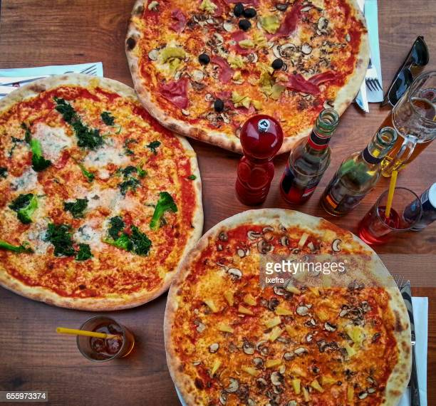 Large pizzas on a table