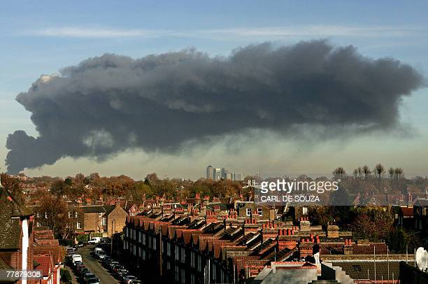 A large plume of smoke rises above east London 12 November 2007 A fire broke out in an old bus garage in east London on Monday police said sending up...