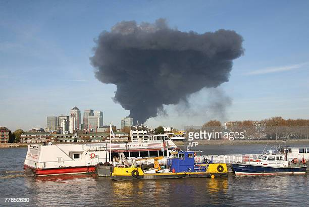 Large plume of smoke rises above the Docklands in east London, 12 November 2007. A fire broke out in an old bus garage in east London on Monday,...