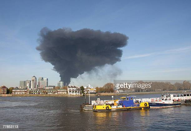 A large plume of smoke rises above the Docklands in east London 12 November 2007 A fire broke out in an old bus garage in east London on Monday...