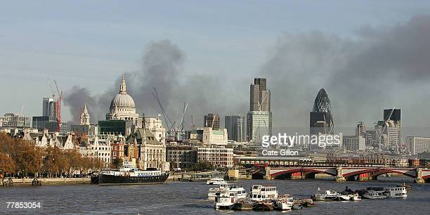 A large plume of thick black smoke is visible across the whole of the London skyline on November 12 2007 in London England The smoke emanating from a...