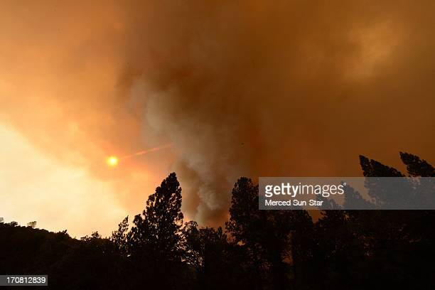 Large plumes of smoke from the Carstens Fire block the sun in the Sierra National Forest near Jerseydale in the Mariposa area June 17 2013
