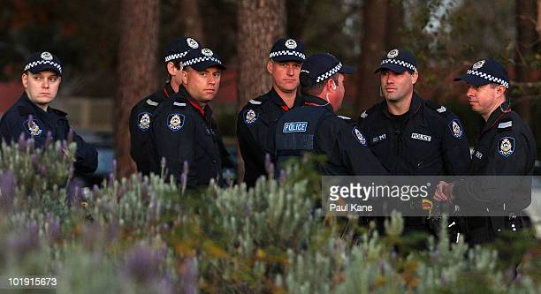 A large police contingent assemble prior to Australian Prime Minister Kevin Rudd arriving for a Community Cabinet meeting at Como Secondary College...