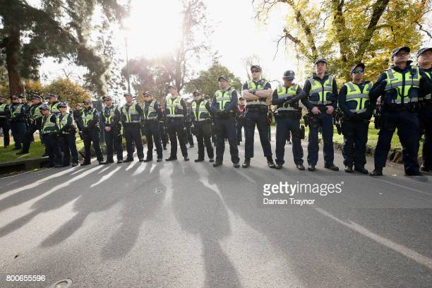 A large Police presence is seen on June 25 2017 in Melbourne Australia An anti racist rally was organised to counter an 'Australian pride march' held...