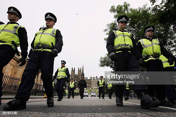 Large police presence patrol the streets of Edinburgh as Campaigners from The Stop The war Coalition march through Edinburgh for a rally on Calton...