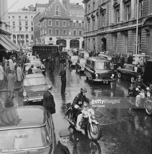 Large police security force arrive at Bow Street escorting twin brothers Ronald and Reginald Kray to court London UK 11th May 1968