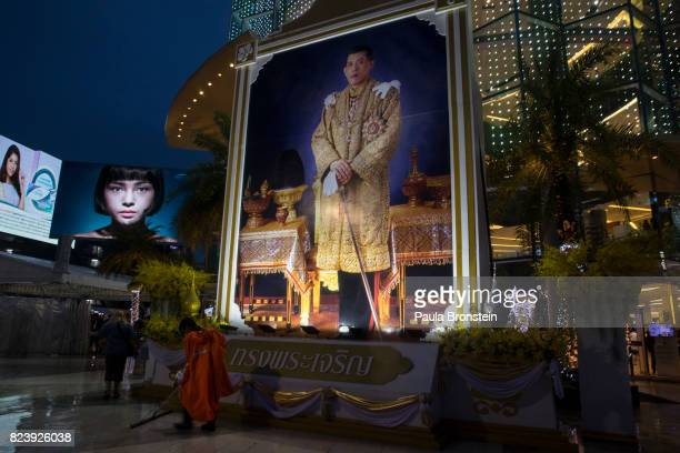 A large portrait of His Majesty the King Maha Vajiralongkorn is seen outside the Paragon shopping mall to celebrate his 65th birthday on Friday July...