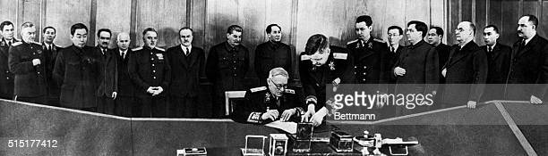 Large, possibly altered picture purporting to show those present at the signing of the Sino-Soviet Friendship Pact of 1950; From left to right are:...