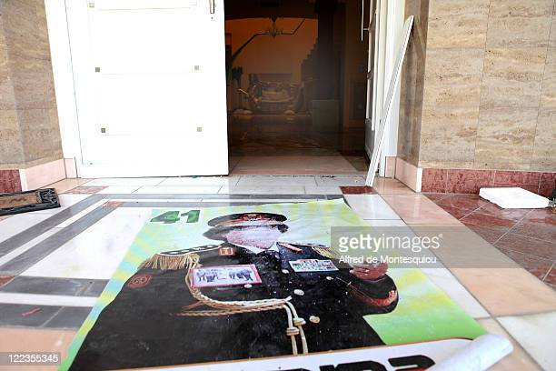 A large poster of Muammar Gaddafi lays on the floor in the entrance of of Aisha Gaddafi's family house on August 27 2011 in Tripoli Libya Houses...