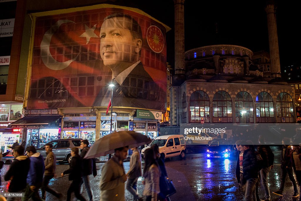 A large poster of Turkish president Recep Tayyip Erdogan is seen on a main street on October 25, 2016 in Rize Turkey. Although born in Kasimpasa, Istanbul, President Erdogan's family was originally from Rize a conservative town on the Black Sea. His family returned to Rize when Erdogan was very young staying until he was 13, before returning to Istanbul. Since the failed coup attempt on July 15, 2016 which saw 240 people killed including 173 civilians, Turkish authorities initiated a state of emergency, leading to an unprecedented crackdown on individuals and organizations with links to US-based cleric Fethullah Gulen and his organization blamed for instigating the uprising. The purge, targeting teachers, journalists, soldiers, judges, academics, police, military leaders, schools and universities has so far seen approximately 100,000 people dismissed, 70,000 detained, 32,000 arrested, 130 media outlets closed and some 15 universities shuttered. The failed coup and subsequent purge only appears to have further bolstered the president's popularity and increased nationalism across the country with July 15th having been marked as a new national holiday. Turkish flags, already prominently displaying all over have increased in numbers, as well as posters of those killed fighting the coup plotters appearing in train stations and public squares. The Bosphorus Bridge in Istanbul, which saw heavy fighting during the coup has been renamed the '15th July Martyr's Bridge'. These changes, follow a year of instability in the country with constant terrorist attacks, an economic downturn, plummeting tourism, and a refugee crisis, all contributing to Turkish society undergoing its most dramatic restructuring in decades.