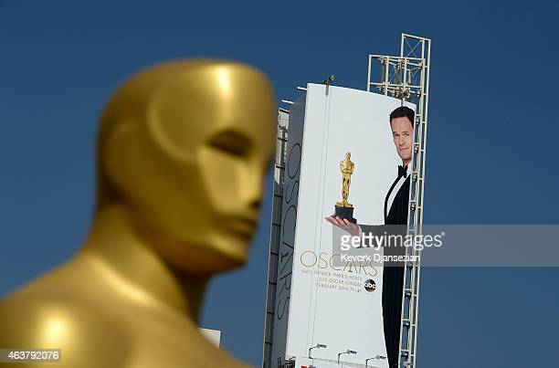 A large poster showing actor Neil Patrick Harris holding an Oscar statue is seen on Hollywood Boulevard during preparation of 87th Annual Academy...