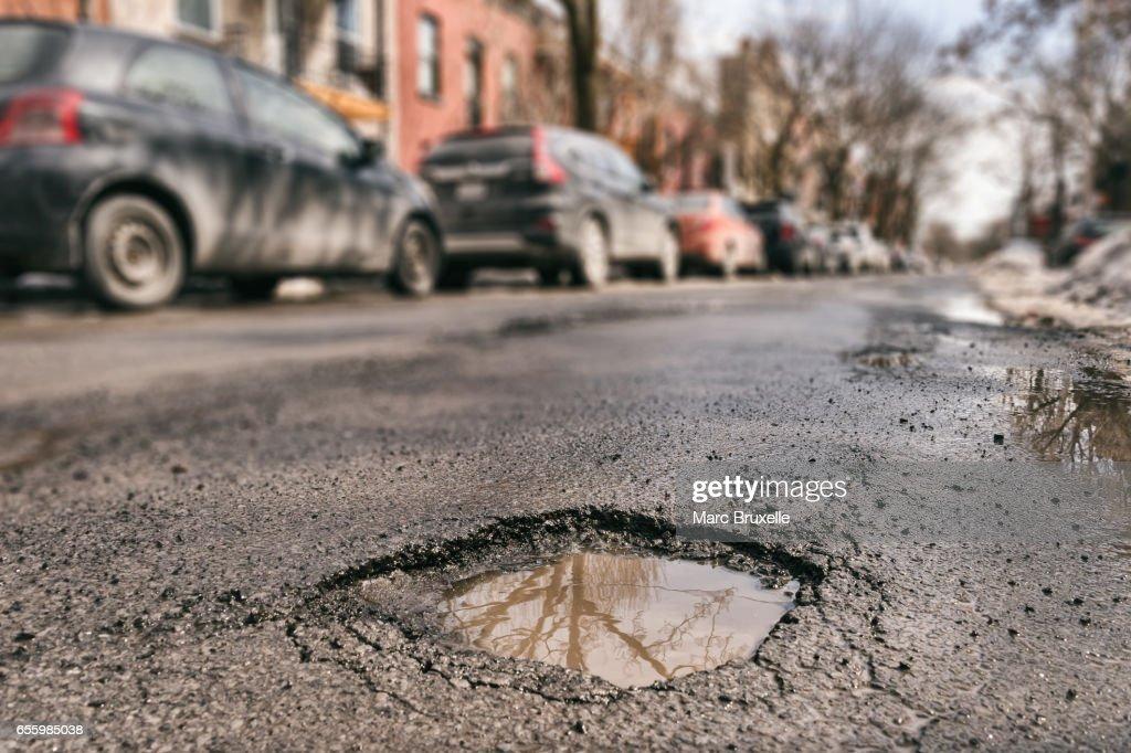 Large pothole in Montreal, Canada. : Stock Photo