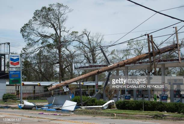 Large power line lies across a Chevron gas station following the passage of hurricane Laura in Lake Charles, Louisiana, on August 27, 2020. -...