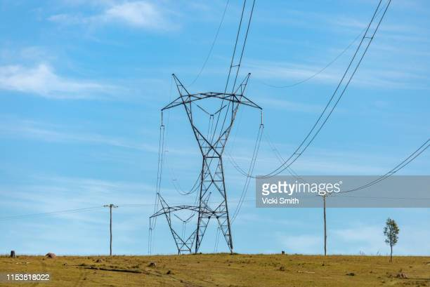 large power poles and lines across the countryside - power line stock pictures, royalty-free photos & images